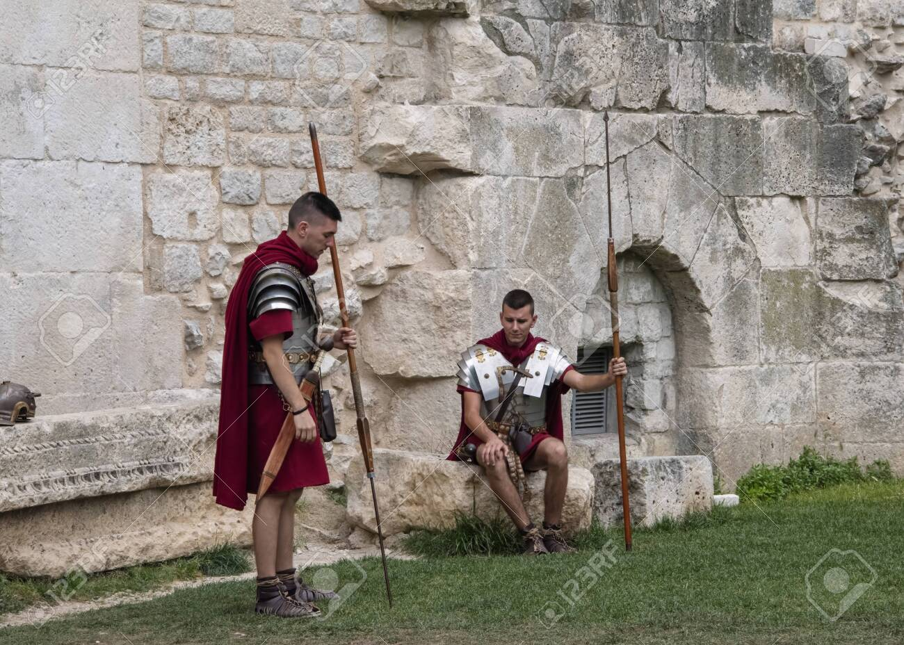 119471174-croatia-split-june-2018-re-enactors-dressed-as-roman-legionnaires-wait-to-pose-with-...jpg