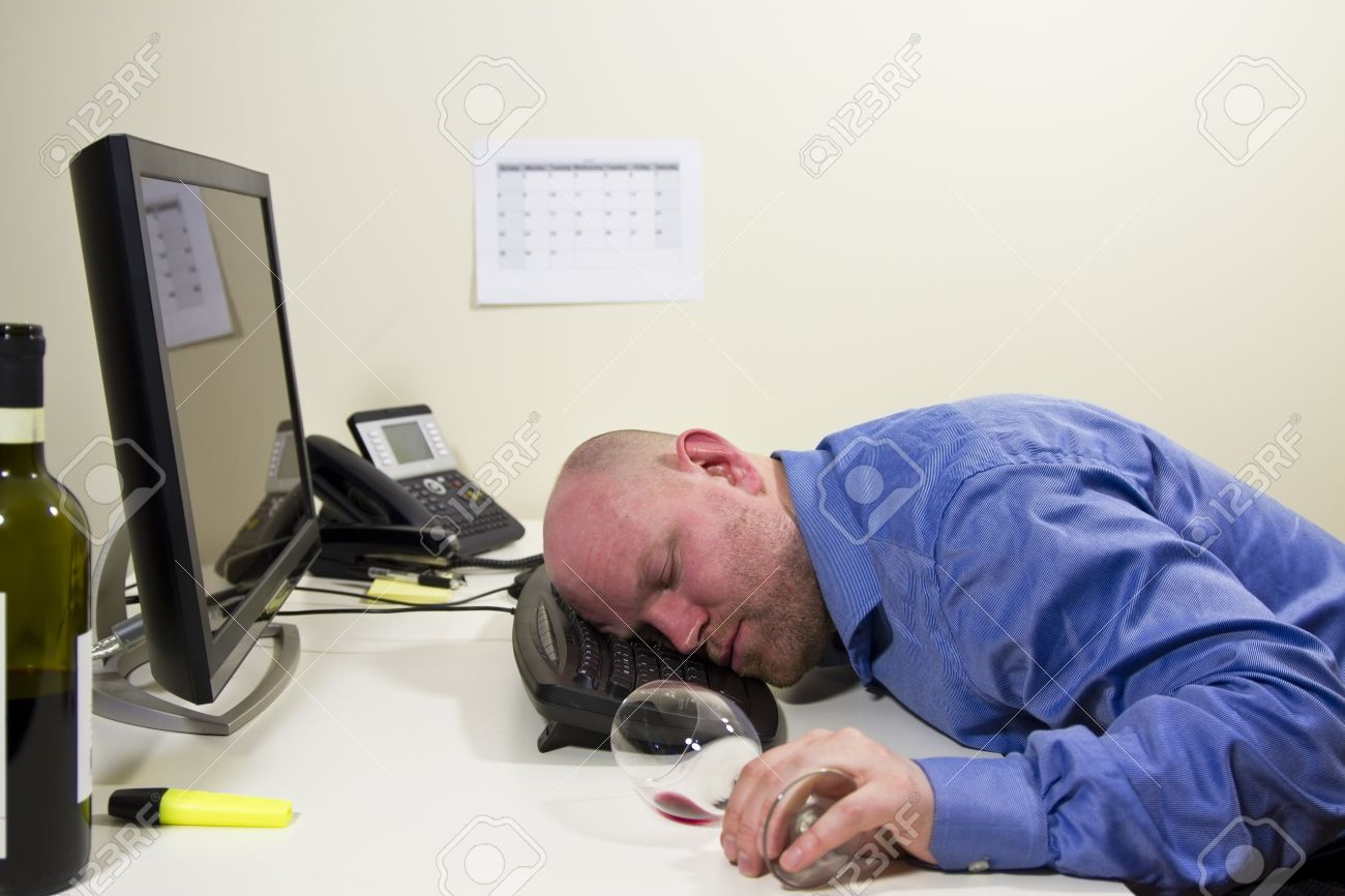 19198425-a-drunk-businessman-office-worker-sleeping-at-his-computer-keyboard.jpg