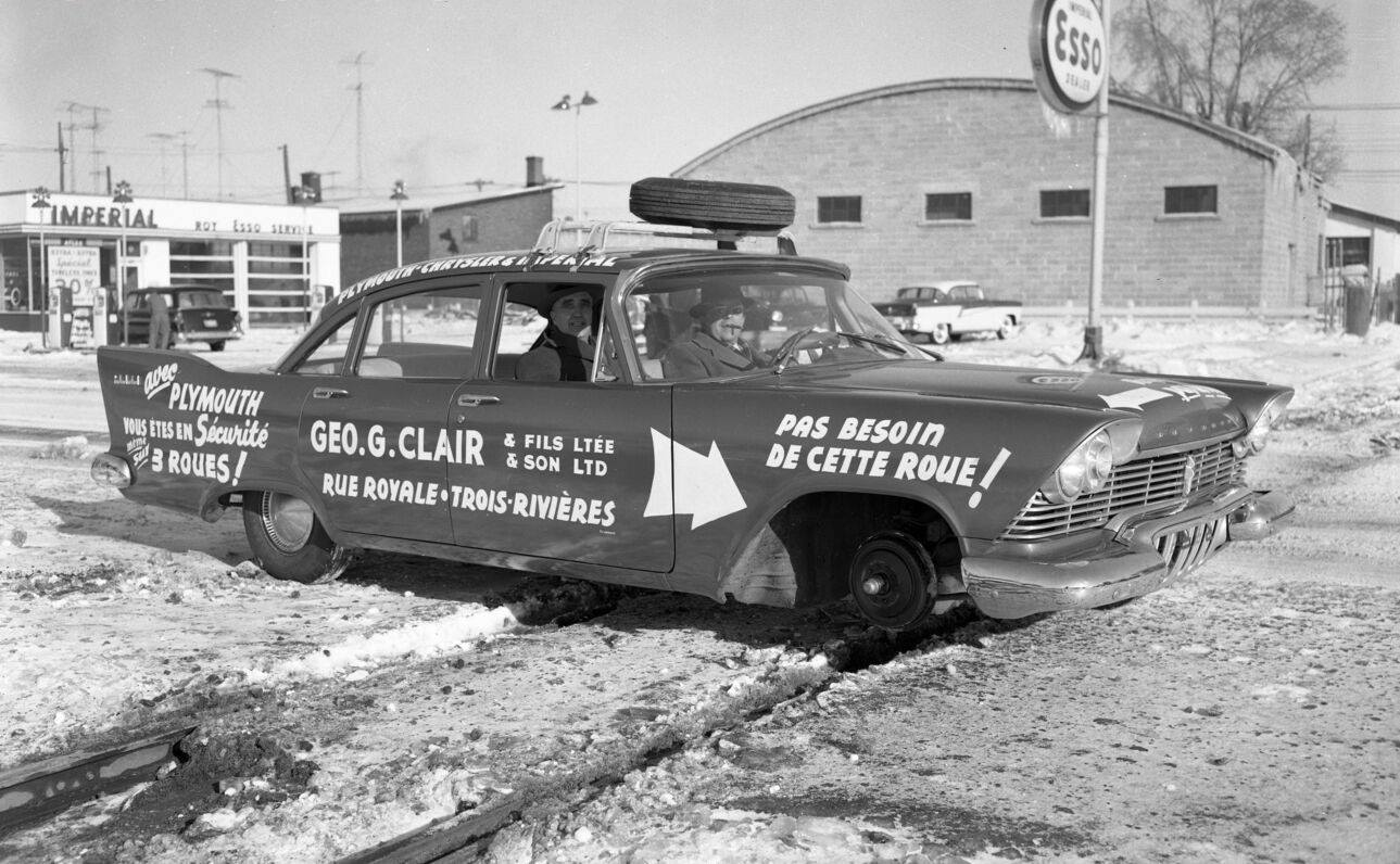 1957 Plymouth with 3 wheels.jpg