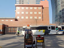 220px-Japanese_Embassy_in_Seoul_and_watched_from_behind_a_bronze_statue_of_comfort_women.JPG