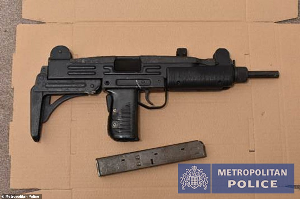 30310070-8482787-The_raids_saw_14_firearms_recovered_including_Scorpion_submachin-a-6_15936912...jpg