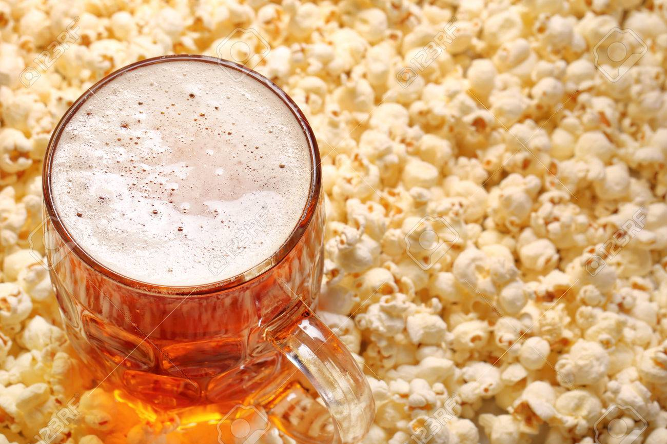 58954615-pint-of-beer-and-popcorn-with-space-for-text.jpg