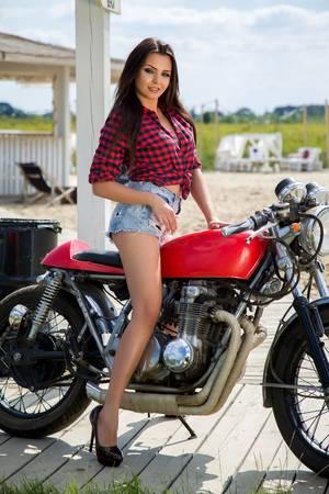 69023430-biker-girl-on-retro-motorcycle-portrait-of-a-cool-woman-on-a-vintage-motorbike.jpg