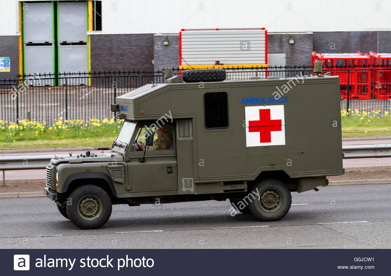 a-british-army-battlefield-ambulance-land-rover-travelling-along-the-G0JCW1.jpg