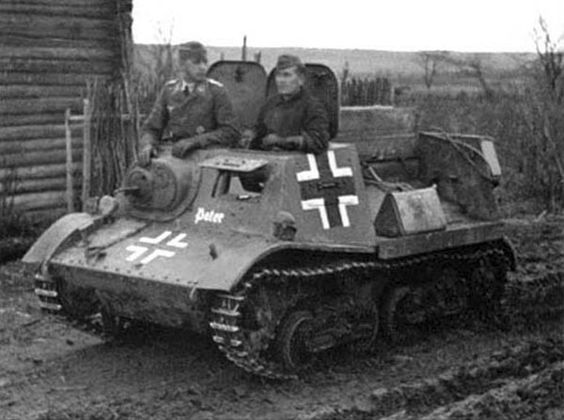 A captured Russian T-20 artillery tractor in Germans use. Germans would often modify the chass...jpg
