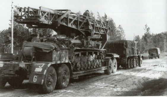 A Famo SdKzf 9 with it's A.h S.d 56 trailer towing a modified Panzer 4 chassis.jpg