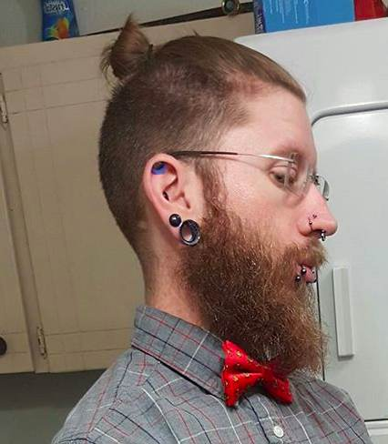 A-selfie-photograph-of-a-hipster-male-with-a-top-knot-undercut-hairstyle-and-a-long-beard.jpg