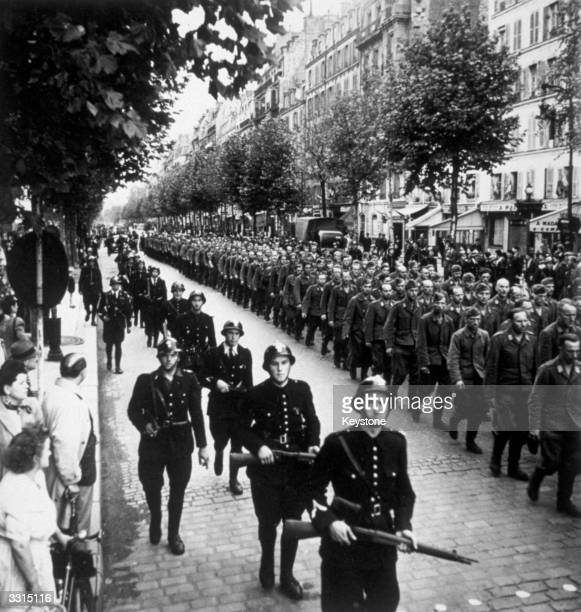 august-1944-guarded-by-the-french-police-german-prisoners-march-the-picture-id3315116.jpg