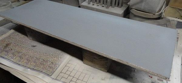 base board in grey primer.jpg