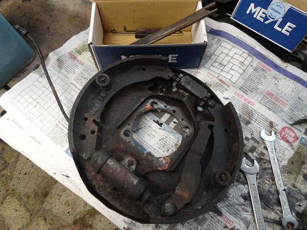 brake backing with parts in box.png
