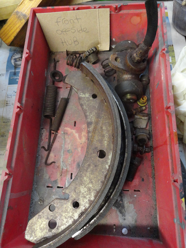 brake parts in red tray.png