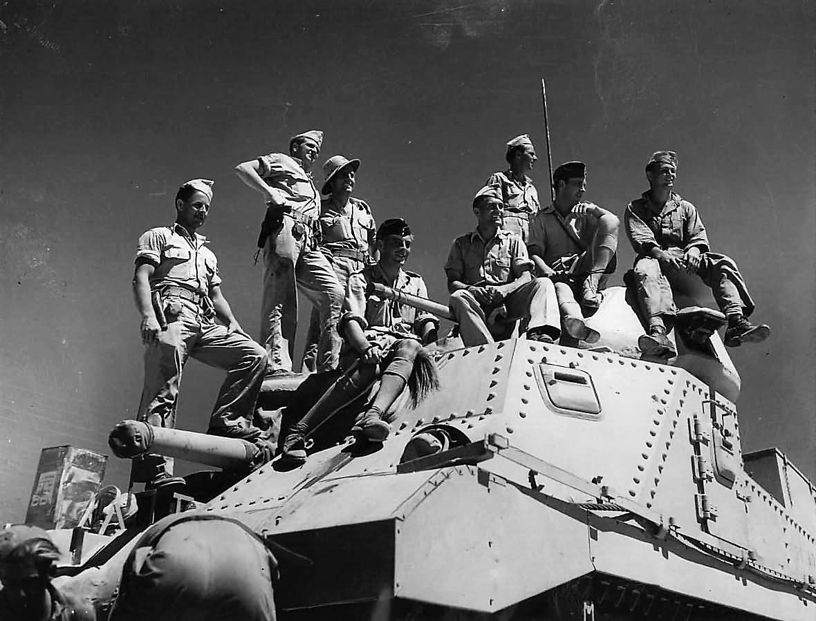 British_and_American_Tank_Crews_atop_M3_Lee_Tank_in_Egyptian_Desert_1942-2.jpg