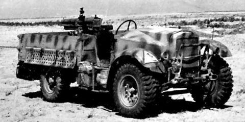 Captured British Morris-Commercial CS8 4x2 trucks with Italian 65.17 gun..jpg