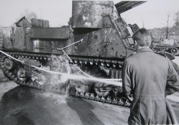 cleaning down the M7B2 fire hose.png