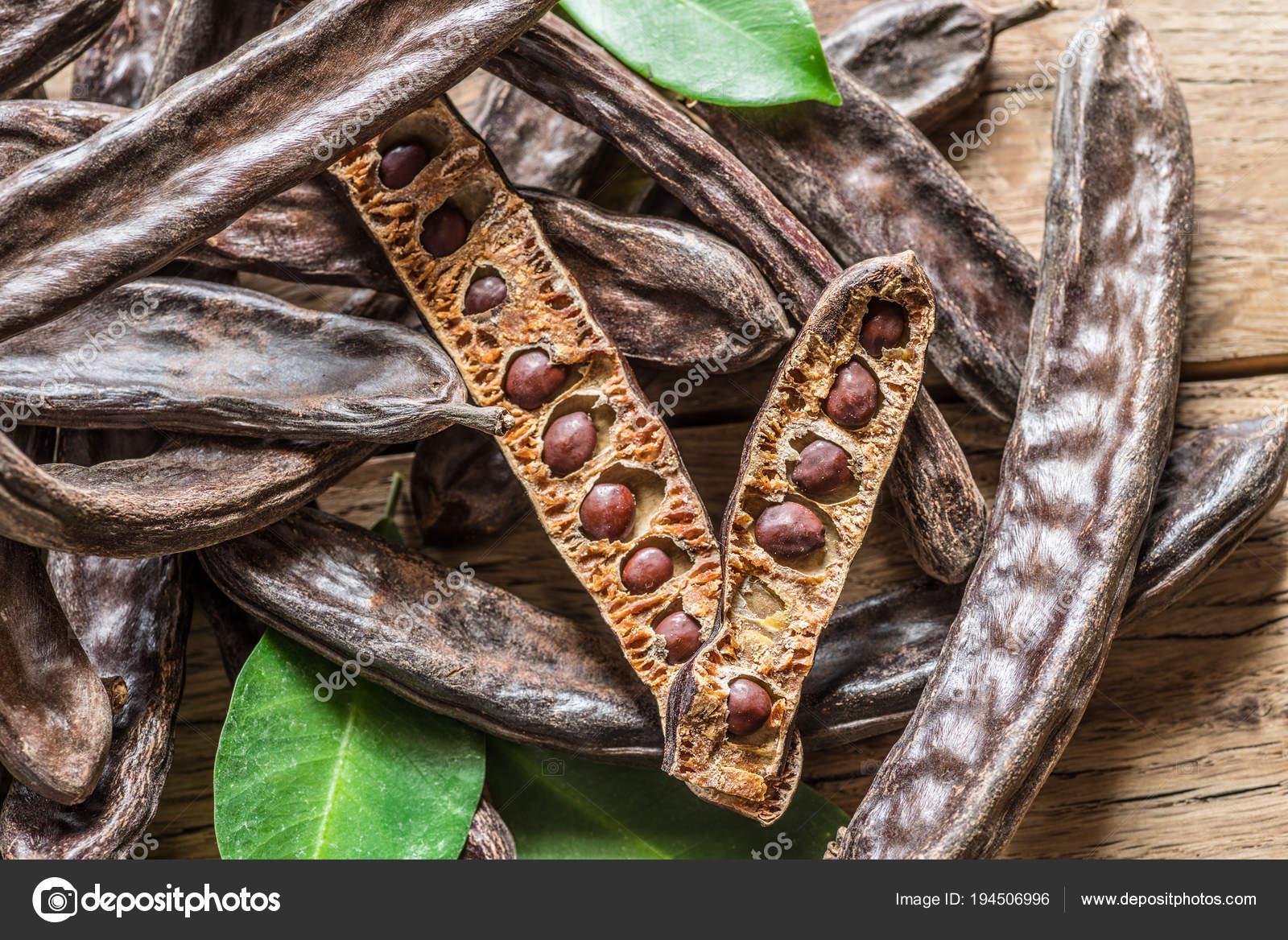 depositphotos_194506996-stock-photo-carob-pods-and-carob-beans.jpg