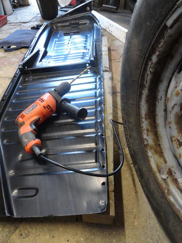 drilling floor pan flange holes.png