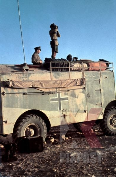 Field Marshal Erwin Rommel watching battlefield 1941 Tunisia in Captured British armoured truck.jpg