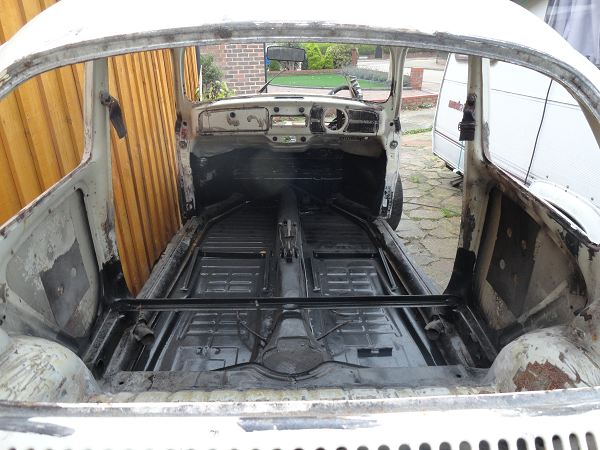 floor view though rear window of first body to chassis test fit a.png