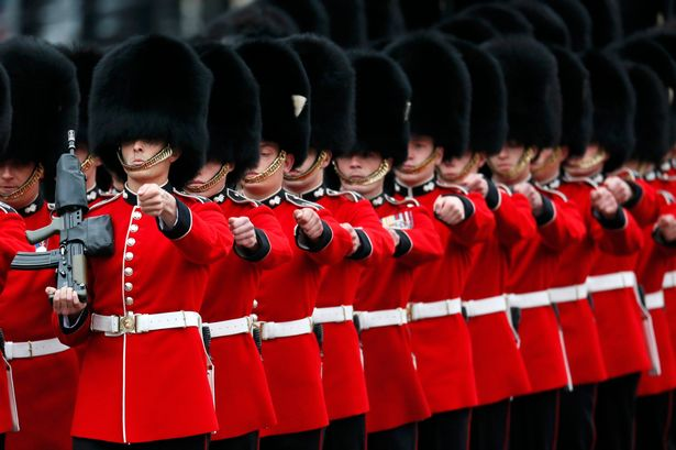 Guardsmen-march-past-Buckingham-Palace.jpg