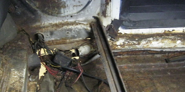 heater channel tail end left rusted out.jpg
