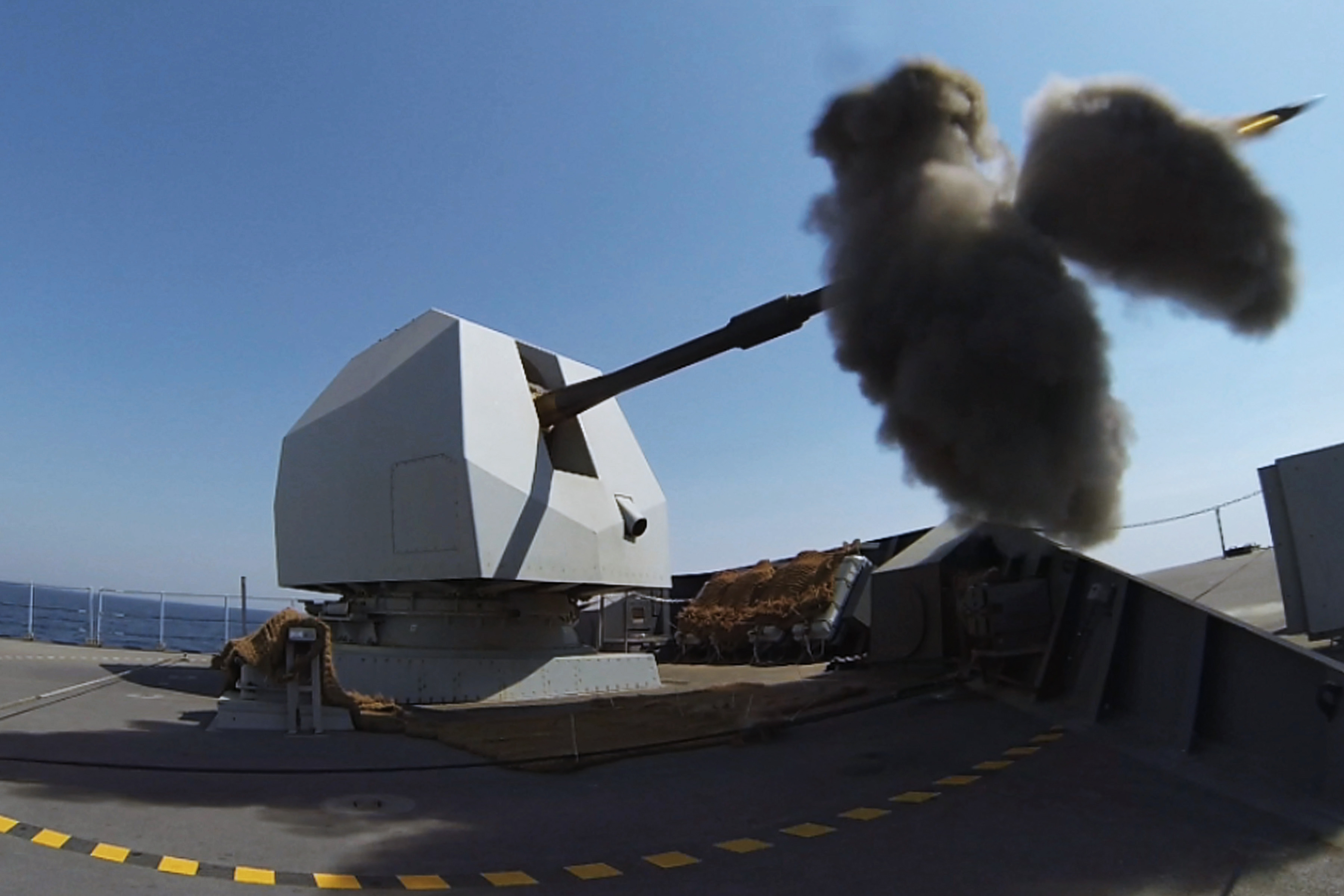 HMS_DEFENDER_fires_her_4.5_inch_Mk_8_Mod_1_naval_gun_MOD_45157963.jpg