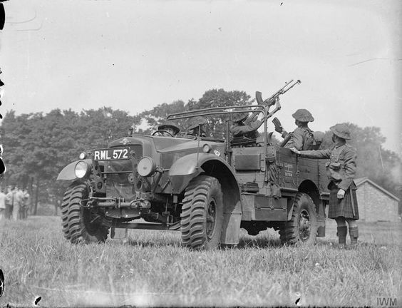 Morris-Commercial 15 cwt truck and men of the 1st Battalion Cameron Highlanders practise with ...jpg