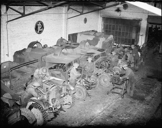 Morris-Commercial CS8 15cwt trucks under repair in a vehicle workshop, December 1939.jpg