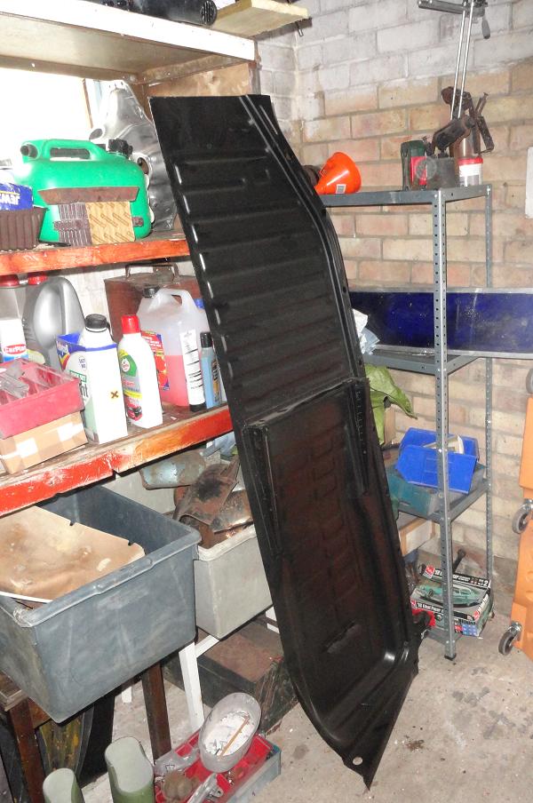 new floor pan half in the garage.png
