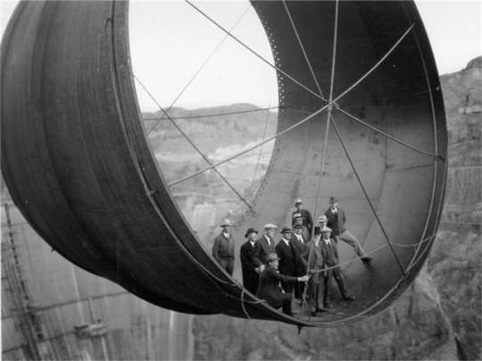 Outlet pipe for the Hoover dam being installed, 1930′s.jpg