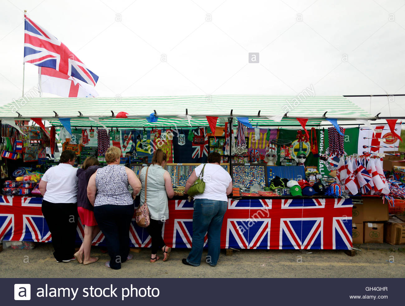 people-look-at-a-gift-stall-before-a-protestant-orange-order-march-Rossnowlagh.jpg