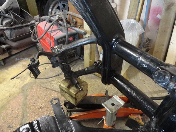 re assembling left suspension arms b.png