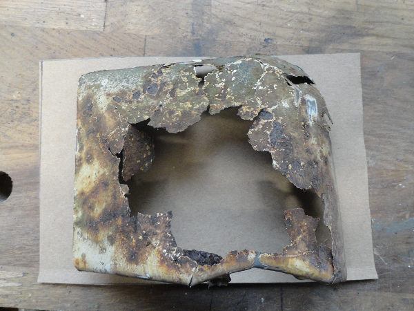 rear nearside arch rust hole cut out on card.png
