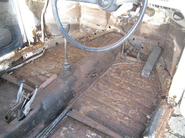 rust holes bare floor forward.jpg