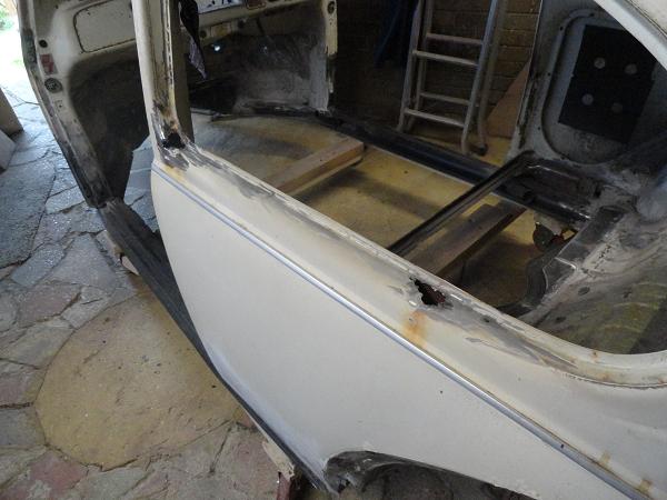 rust holes in r n s window frame bottom.png