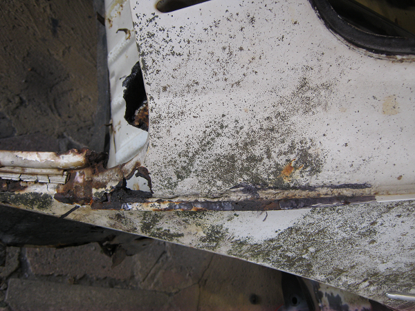rusted out section of rear scuttle right side.png