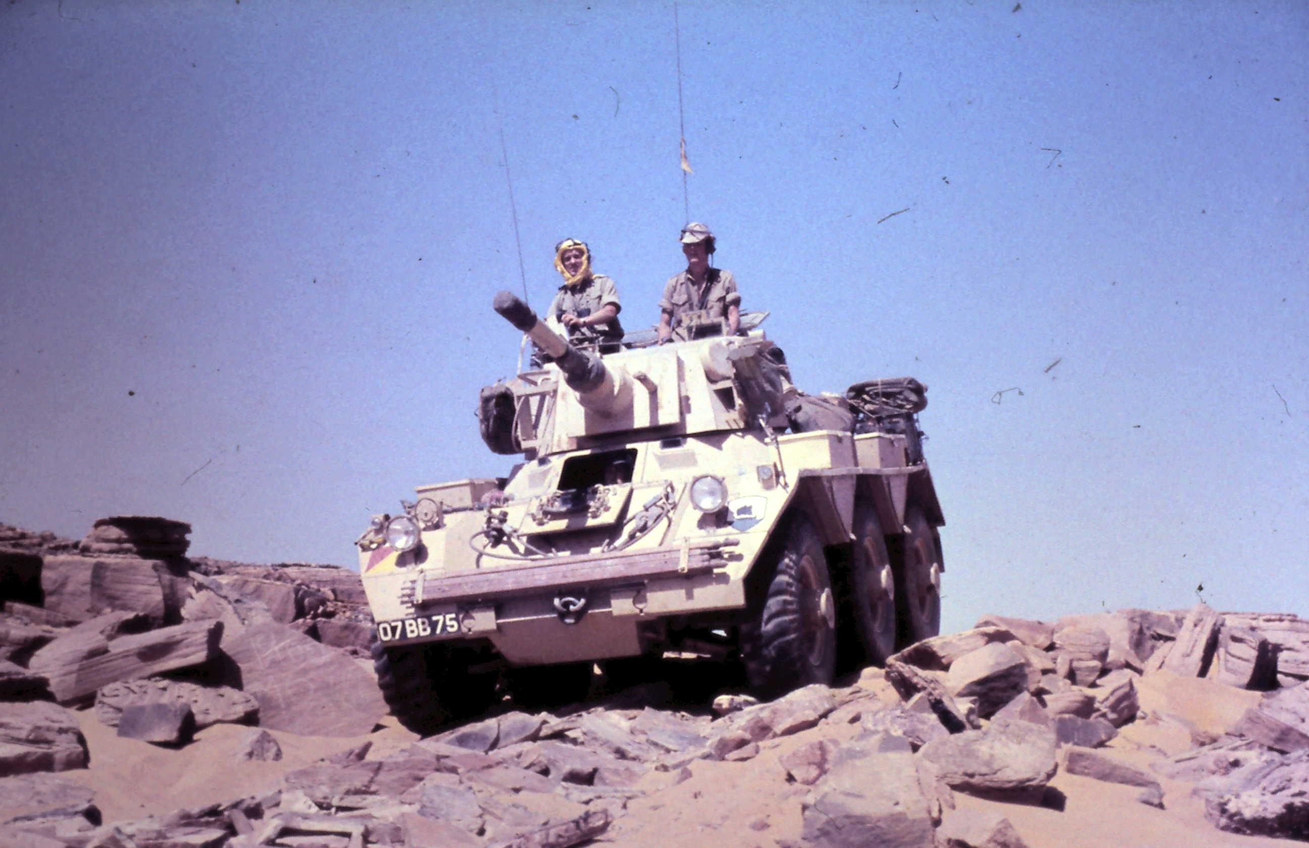 Saladin 07BB75 (Lt Wilson, Tpr Messenger and Peake descending the escarpment.JPG