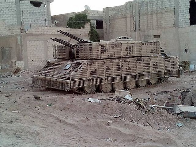 Syrian_army_uses_local-made_armour_cage_to_increase_protection_of_T-72_tanks_and_ZSU-23-4_640_...jpg