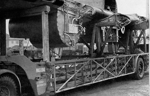 The wings and central fuselage section of a plane on one of the 60ft 'Queen Mary' trailers use...jpg