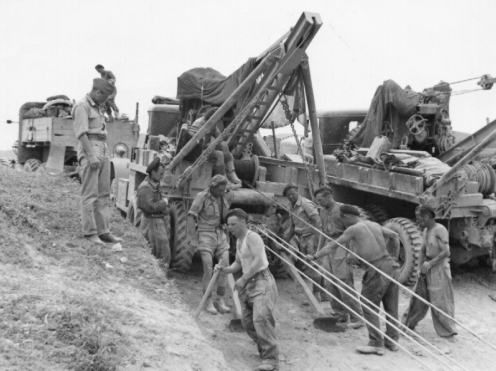 Two REME Ward La France heavy 6x6 wreckers with Gar Wood jibs, in use by the British during a ...jpg