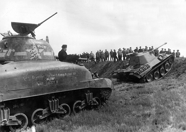 "War Daddy II,"" a captured American Sherman (left) is tested against a German Panther and oth...jpg"